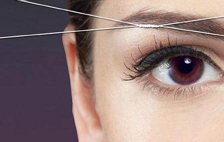 Как удалить волосы нитью на лице